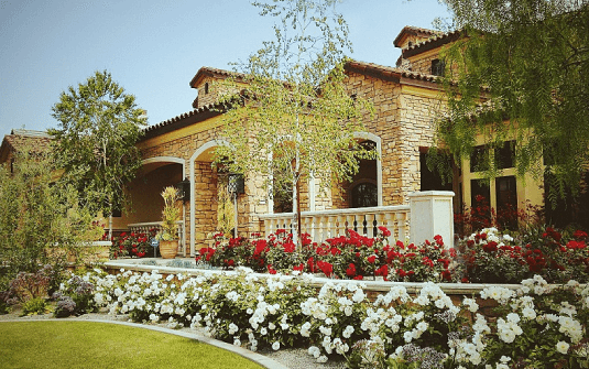 large estate in southern california with landscaped trees and yard